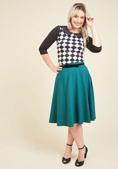 <p>Show off your stylish smarts at the midday match with the help of this checkered top! In addition to its black and white motif, this always-game garment offers cropped sleeves, a charming Peter Pan collar, and a retro vibe that simply can't be beat. Checkmate!</p>