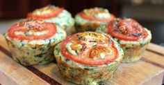 A cheesy muffin with cheddar and feta and spinach, topped with thinly sliced tomatoes. There's thyme in there too!