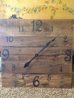 This large square pallet clock measures 24x24. It has been made from reclaimed pallet boards. The numbers have been painted in black and the