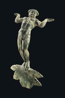 A GREEK BRONZE VESSEL HANDLE HELLENISTIC PERIOD, CIRCA 3RD CENTURY B.C.