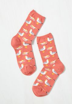 Never a Gull Moment Socks. For a boardwalk tenant, life is full of tasty surprises, and these orange crew socks are a celebration of flavor! #coral #modcloth