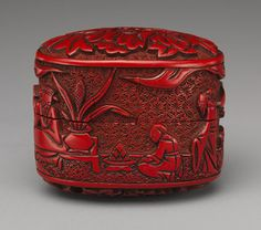 """""""figures in a landscaped garden"""" red lacquered Japanese box, 18th century."""