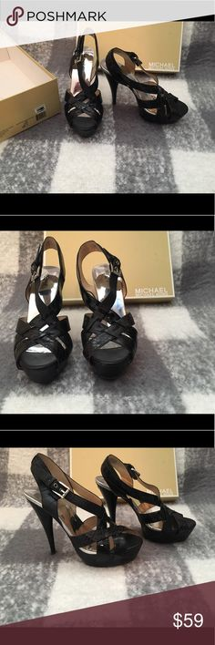 MICHAEL Michael Kors Niki Cross Strap Heels Used MICHAEL Michael Kors Niki Cross Strap Heels Black Snake Leather  Size: 8 I have other items listed in my closet. If you're interested in this, you might be interested in something else I have up. Check it out. :) Happy shopping! ⭐️ Top-rated Seller! 📦Fast Shipper! 💵Reasonable Offers Considered MICHAEL Michael Kors Shoes Heels