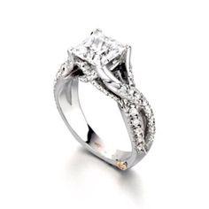Modern princess cut diamond engagement ring.