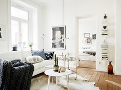 Vibrant white home with old hardwood floors