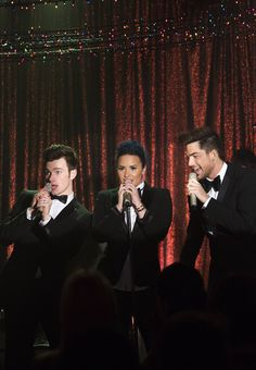 "Adam Lambert with Chris Colfer and Demi Lovato, performing a song from an upcoming episode of ""Glee"""