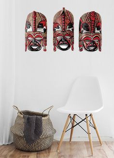 Beautiful simple interior space with bold red and black hand carved African masks.  The Maasai people pass these masks down from generation to generation to honor their ancestors. When doing this, it is believed that the ancestors will pass down blessings to the owner.  This African inspired interior space looks like a bohemian travelers getaway!  #african #interior #home #homedecor #africa #african #africanmasks #woodcarving #decorate #artwork #renovate #renovation #minimalist #bohemian…