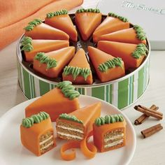 """Each """"pie slice"""" is a wedge-shaped Petit Four arranged beautifully in a decorative tin. Layers of spiced carrot cake and cream cheese filling Coated with confection and hand-decorated Neatly arranged in a """"pie"""" so everyone gets a slice"""