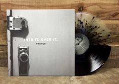 nosleeprecords:  Into It. Over It.'srepress of 'Proper' on Half Black / Half Clear w/ Black Splatter is in stock and shipping now!