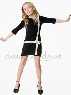 "Sample DescriptionDeux Par Deux Girls Falling In Style Knit Black Dress FALL 2013 PREORDER   + view larger image   Price: $58.00 - $62.00    From the ""Falling in Style"" collection by Deux Par Deux, girls knit black dress with white accents. Litte girls and girls sizes 4-12. FALL 2013 PREORDER  Knit black dress Three quarter sleeves Cotton Machine wash"