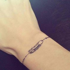 Feather bracelet tattoo, perhaps with a forget me not?? Or yellow and blue to…
