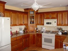 Kitchen Cherry Cabinets | Cambria. To learn more about Cambria, visit there