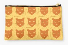 A cute cat pouch to store supplies. http://www.redbubble.com/people/hollyddesigns/works/21291064-block-print-cat?p=pouch