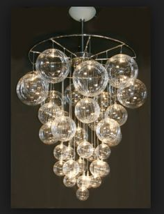 cool modern chandelier with glass globe crystal balls hanging in different sizes and at different lengths