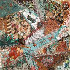 Crazy quilt with buttons,  art fibers, beading, silk ribbon flowers, motifs and ornate embroidery  stitching.