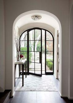 Sugar Creek - mediterranean - Entry - Austin - Ryan Street & Associates love this type of window/door + light walls + dark floors + simple bold lines on table