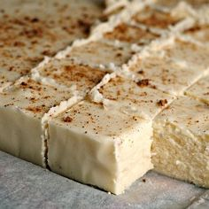 Egg Nog Fudge-2 cups granulated sugar  ½ cup unsalted butter  ¾ c egg nog  salt  11 oz white chocolate, chopped  ½ tsp nutmeg   1 jar marshmallow fluf   1tsp rum extract  Combine sugar,butter,egg nog over med heat.Bring to rolling boil,Continue boiling 8 to 10 minutes,stirring constantly;remove from heat.Add white chocolate in mallow extract.Beat& Pour.Sprinkle ground nutmeg on top.Leave at room temperature until cooled, then refrigerate   When completely cool, cut into squares.
