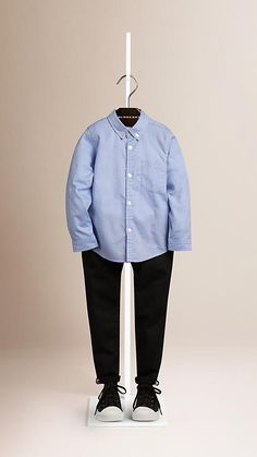 A classic cornflower blue Oxford shirt in cotton with a button-down collar from Burberry.