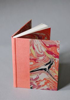 For the swirling thoughts in your head: a marbled journal in coral, cerise, and green with coral linen binding by NatalieAsIs.