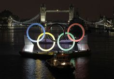 Backdropped by Tower Bridge, giant Olympic Rings float on the River Thames in London during its launch to mark 150 days before the start of the London 2012 Olympic and Paralympic Games. (AP)