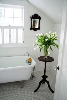 A Country Farmhouse Blog: Upstairs Master Bath. The blog is about a couple's renovation of an old farmhouse. Love the plant stand.