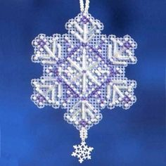 Amethyst Crystal - Snow Crystals Charmed Ornaments 2012 Mill Hill Beaded Cross Stitch Christmas Ornament Kit with Charm MH162303 Amethyst Crystal is one of six classic ornaments in the 2012 Mill Hill Snow Crystals collection! Makes one beaded cross stitch Amethyst Crystal Charmed Christmas Ornament featuring a Mill Hill Star Snowflake Charm. Use as an ornament with beaded hanger (included) or with cardstock to make a greeting card or gift tag (not included.)...
