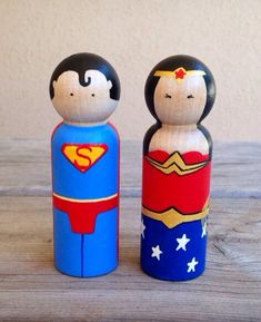 Superman and Wonder Woman peg doll cake topper  on Etsy, $18.00