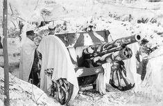 The most common Finnish artillery in Winter War (1939-1940)  was a 76mm gun dating back to around the year 1902 (76 K 02). The gun stands camouflaged in the city of Viipuri in March 1940.