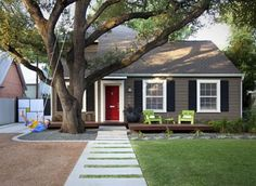 The white trim with the contrasted paint and shutters and red door. LOVE