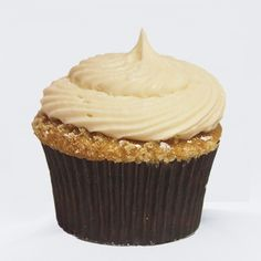 Vanilla cupcake crowned with cinnamon streusel and topped with maple buttercream frosting and sprinkled with cinnamon sugar and powdered sug...