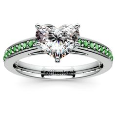 Glittering green emeralds lend a beautiful vivacity to this gemstone pave setting like no other... Breathe freshness into that Forever moment with the Cathedral Emerald Gemstone Ring in durable Platinum, featuring a sweet Heart-cut center diamond! http://www.brilliance.com/engagement-rings/cathedral-emerald-gemstone-ring-platinum