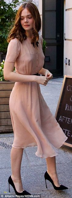 A tale of two outfits: Elle Fanning wore two different vintage style dresses in New York C...