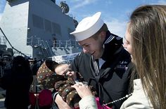 NORFOLK (March 28, 2013) Construction Mechanic 2nd Class Jeff Reyes, assigned to the guided-missile destroyer USS Winston S. Churchill (DDG 81), meets his baby for the first time as the ship arrives in Norfolk. Winston S. Churchill returned from a deployment to the U.S. 5th and 6th Fleet area of responsibility. (U.S. Navy photo by Mass Communication Specialist 3rd Class Sabrina Fine/Released).