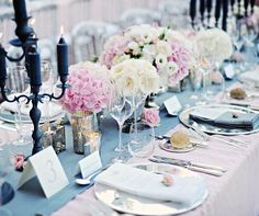 A touch of shine from mercury votive holders and silver chargers amps up this soft palette.