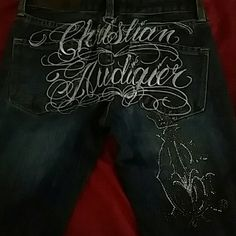 Christian Audigier jeans Christian Audigier was a French fashion designer known for The Ed Hardy and Von Dutch clothing lines.... Waist 25 length 34  jeans with Crystals going down the back leg.   These are a very good quality of denim. And very cute jeans!! Christian Audigier Pants