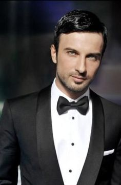 Tarkan, Turkish megastar. There's nothing like a classic tux and razor sharp hair to go with a little scruff.