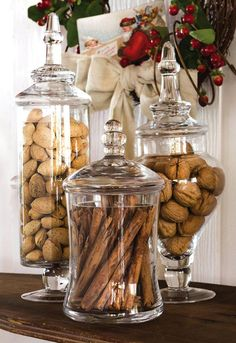 kitchen island decor Our Apothecary Jar Set makes a lovely show of nuts, cinnamon sticks and ca. Kitchen Island Decor, Home Decor Kitchen, Kitchen Interior, Home Kitchens, Kitchen Island Centerpiece, Apothecary Jars Kitchen, Kitchen Jars, Decorated Jars, Glass Bathroom