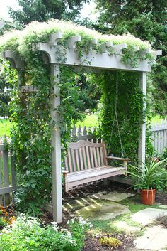 Vine covered arbor and comforting garden swing.