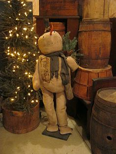 Grungy Prim...Snowman...old wooden barrels & Christmas tree.