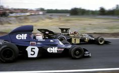 World Champion #1 Emerson Fittipaldi's John Player Lotus ahead of  Jackie Stewart #5 Elf Team Tyrrell. A great 1970's rivalry. I know which one won more championships, but I also know which one was the faster driver.