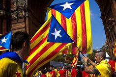 "Estelada flags, that symbolize Catalonia's independence, in Barcelona. ""Catalan delegates petition Cameron for their own referendum"" The Times"
