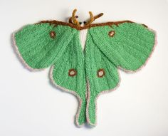 I'm Max Alexander and I love knitting moths. Until last year I spent most of my time making knitting and craft themed jewellery and occasionally knitting strange creatures. Then a friend mentioned that he thought a knitted Rosy Maple Moth… Rosy Maple Moth, Knitting Patterns, Crochet Patterns, Knitting Ideas, Wool Shop, Crochet Butterfly, Knitted Flowers, Knitted Animals, Fabric Jewelry