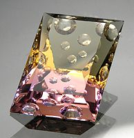 Ametrine-hand carved and faceted by Allyce Kosnar