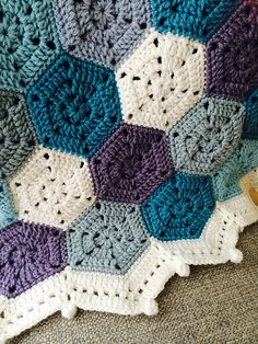 This pattern is for a lap or smaller bed blanket and is constructed in a modular style with joins made through the corners of each hexagon.