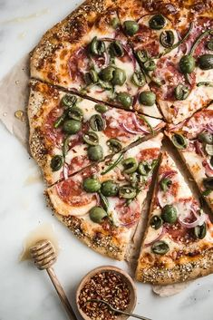What's better than homemade pizza? Super duper easy homemade pizza, loaded with salami, onions, olive and jalapeño, with honey drizzled all over it!