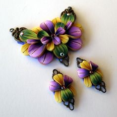 Pansies Polymer Clay Pendant Craft Supplies. $26.00, via Etsy.
