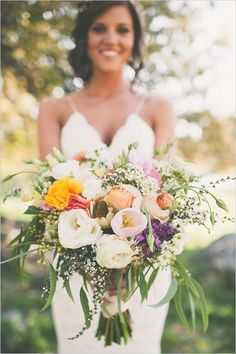 Peach and lavender hand tied bouquet for outdoor wedding | Our Favorite Wedding Bouquets via @alowcountrywed