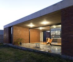 """Especially designed to respond to the demands of a young professional couple who applied for the mortgage loan """"PRO.CRE.AR"""", the house lies on the outskirts of Pilar in Buenos Aires. As a consequence of dividing the land of former farms into lots, single-"""
