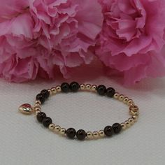 Bracelets for mother and daughter made of gold filled, garnet, silver, and other high quality gemstones.