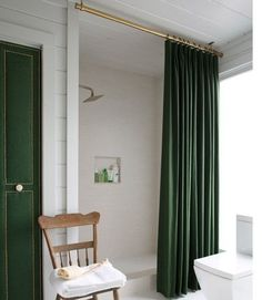 The same basic theory works with your shower curtain, too: Spray-paint a shower rod gold and suspend it from the ceiling. | 40 Easy DIYs That…
